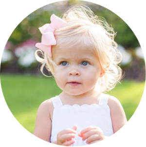 blonde toddler girl with hair bow