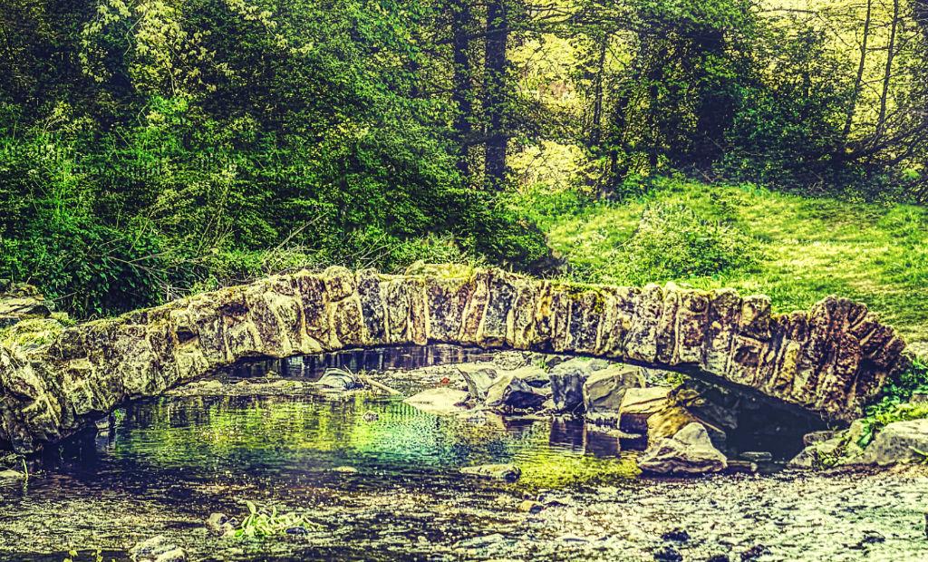 a strong stone bridge across a river